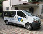"У Херсоні працює ""Соціальне таксі"". херсон, особливими потребами, соціальне таксі, інвалід, інвалідність, building, land vehicle, outdoor, vehicle, car, wheel, transport, vehicle registration plate, compact van, auto part. A van parked in front of a building"