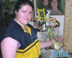Найсильніша жінка України не чує і погано бачить. виктория степанюк, армреслінг, гирьовий спорт, спортсмен, фізична вада, person, smile, human face, clothing, man. A person posing for the camera
