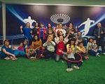 Спортивні можливості для діток, що мають аутизм. київ, аутизм, проект kids autism games, соціалізація, тренування, grass, indoor, person, posing, playground, clothing, smile, several. A group of people posing for the camera