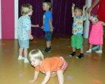 «Щасливі наші діти, поки живі батьки». Раннє втручання дає шанс дітям з інвалідністю. аутизм, допомога, раннє втручання, синдром дауна, інвалідність, floor, child, person, indoor, baby, little, clothing, young, human face, footwear. A little girl that is standing on the floor