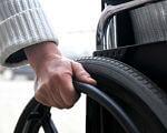 У Рівному люди з особливими потребами зможуть обирати собі помічників. Офіційно. рівне, опікунська рада, положення, помічник, інвалідність, person, car, outdoor, tire, auto part, camera, synthetic rubber, wheel, close. A close up of a person driving a car