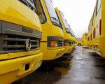 У Рівному покращують доступність маршруток для візочників (АУДІО). рівне, візочник, доступність, маршрутка, обмеженими фізичними можливостями, yellow, outdoor, vehicle, land vehicle, transport, wheel, bus, car, rainy. A yellow bus is parked on the side of the road