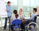 На Кіровоградщині цьогоріч здобули нову професію понад 80 громадян з інвалідністю. кіровоградщина, направлення, професійне навчання, центр зайнятості, інвалідність, person, wheelchair, clothing, chair, woman, cart. A group of people looking at a laptop