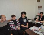 Забезпечення доступності. знам'янський район, дитина-інвалід, доступність, засідання, інвалідність, person, wall, indoor, clothing, computer, people, laptop, woman, furniture, group. A group of people in a room