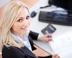 Наполегливість та цілеспрямованість – шлях до втілення мрій у життя. підприємець, самореалізація, соціальна послуга, центр зайнятості, інвалідність, person, human face, indoor, smile, woman, clothing, book, computer, mobile phone. A woman sitting at a desk