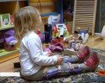 """""""Де гроші?"""": чому дітям в Україні відмовляються виготовляти ортези (ВІДЕО). діагноз, ортез, ортопедична майстерня, фінансування, інвалід, person, indoor, toddler, baby, child, clothing, human face, boy, toy, girl. A little girl sitting at a table"""
