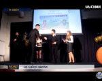 Проект сумського «Фенікса» переміг у Всеукраїнському конкурсі (ВІДЕО). суми, соціальний проект, спортивний клуб інвалідів фенікс, інвалідність, інтеграція, person, clothing, screenshot, suit, man, set. A group of people standing in front of a television