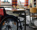 Півасистента, або Інклюзія по-українськи. асистент учителя, особливими освітніми потребами, інвалідність, інклюзивна освіта, інклюзія, furniture, table, indoor, floor, chair, desk, shelf, kitchen & dining room table, cluttered. A group of people sitting in a chair