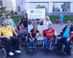 Любимый город должен стать комфортным. днепр, доступность, инвалидность, пандус, универсальный дизайн, person, clothing, outdoor, wheelchair, footwear, woman, man, smile, transport, group. A group of people sitting posing for the camera