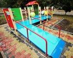 У Полтаві з'явиться перший інклюзивний дитячий майданчик. інклюзивний дитячий майданчик, полтава, бюджет участі, особливими потребами, проект, tree, playground, outdoor, swimming pool, swimming, colorful, pool, colored. A close up of a colorful wall