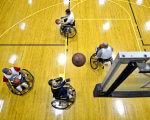 Тепер особи з інвалідністю. Що це змінює? (ВІДЕО). конвенція оон, візочник, формулювання, інвалід, інвалідність, sports equipment, bicycle, floor, bicycle wheel, indoor, basketball, wheel, land vehicle, bicycle helmet. A wooden table