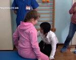 У центрі «Особлива дитина» запровадили новий метод терапії (ВІДЕО). чернівці, бобат-терапія, метод, центр особлива дитина, інвалідність, person, indoor, floor, clothing, human face, child, toddler, boy. A group of people standing in a room