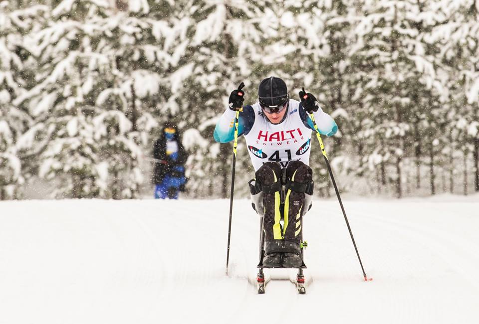 Українські паралімпійці завершили передпаралімпійський сезон 35-ти медалями кубку світу. кубок світу, біатлон, змагання, лижні перегони, паралімпиєць, snow, outdoor, skiing, tree, ski, snowboarding, sports equipment, cross, person, snowboard. A man is cross country skiing in the snow