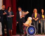 На Вінниччині відбувся перший в Україні інклюзивний спектакль «Пори року. Yes, I can». вінниця, творчість, інвалідність, інклюзивний спектакль, інклюзія, person, standing, group, curtain, clothing, posing, people, wheelchair, suit. A group of people posing for the camera