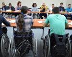 Дві історії успіху від людей з необмеженими можливостями. валентин венгловський, оксана вахнюк, підприємець, тренинг, інвалідність, person, wheelchair, indoor, people, clothing, group, chair, table. A group of people sitting at a table