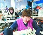 Хоча мають проблеми зі слухом, до людського болю не глухі…. ужгород, глухий, підприємство, швачка, інвалідність, person, table, indoor, clothing, child art, working. A person sitting at a desk