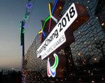 Паралімпіада-2018: Пробудимо розум, загартуємо тіло, зміцнимо дух. паралімпіада-2018, змагання, паралімпиєць, спортсмен, інвалід, outdoor, sign, skyscraper, billboard, night, sky, light, building, crowd. A stop sign at night