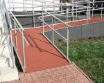 МЭРТ предлагает обязать малый и микробизнес оборудовать пандусами вход в рестораны и магазины. мэрт, инвалидность, пандус, постановление, приспособление, outdoor, stairs, playground, plant. A large red brick building