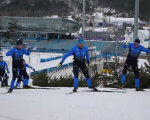 Українські паралімпійці за 4 дні до початку Паралімпіади-2018 (ВІДЕО). паралімпіада-2018, паралімпійські ігри, паралимпиец, паралімпійська збірна, тренування, snow, outdoor, skiing, sports equipment, ice skating, snowboarding, person, hockey, footwear, ski. A group of people riding skis on top of a snow covered slope