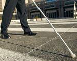У кожного свої здібності, або приклади професій, де можуть реалізуватися особи з інвалідністю. Частина 3. незрячий, порушення зору, працевлаштування, роботодавець, інвалідність, road, outdoor, trousers, footwear, person, sidewalk, way, jeans, street, clothing. A person standing on a sidewalk
