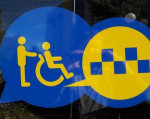 "У Івано-Франківську планують створити ""Соціальне таксі"". івано-франківськ, допомога, послуга, соціальне таксі, інвалідність, tree, blue, sign, outdoor, helmet. A blue sign in front of a building"