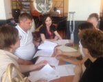 К концу мая в Мелитополе заработает социальное такси. мелітополь, инвалидность, проект, социальное такси, транспортная услуга, person, indoor, sitting, human face, clothing, woman, group, smile, people, girl. A group of people sitting at a table