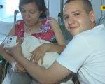 У Дніпрі жінка, яка пересувається на інвалідному візку, та зі складною хворобою народила сина (ВІДЕО). дніпро, вагітність, кесарів розтин, хвороба, інвалідний візок, person, human face, indoor, smile, clothing, woman, baby, scene, hospital room, room. A person holding a baby
