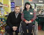 Ринок праці для людей з інвалідністю. Як це працює у Вінниці. вінниця, працевлаштування, роботодавець, супровід, інвалідність, person, indoor, clothing, smile, furniture, woman, human face, store, shop. A man and a woman standing in front of a store