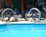Как заботятся о людях с инвалидностью в странах Евросоюза. кипр, мариуполь, доступ, инвалидность, пляж, bicycle, blue, outdoor, wheel, bicycle wheel, land vehicle. A bicycle is parked next to a pool of water