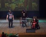 У Запоріжжі представили інклюзивний спектакль на підтримку онкохворого актора (ВІДЕО). запоріжжя, актор, постановка, спектакль, інвалідність, floor, clothing, indoor, person, footwear, screenshot. A group of people in a room