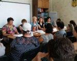 В Каменском провели ярмарку вакансий для людей с инвалидностью. каменское, инвалидность, работодатель, центр занятости, ярмарка вакансий, person, clothing, group, people, human face, indoor, table, woman, man, room. A group of people sitting at a table