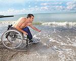 В Одессе доработали проект пляжа для людей с инвалидностью на 11-й станции Большого Фонтана. одесса, инвалидность, пляж, проект, совещание, water, outdoor, sky, beach, person, shore, ocean, nature, clothing. A person riding a bicycle on a beach