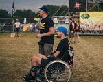 """Фестиваль """"Файне Місто"""" реалізовує соціальні ініціативи для людей з інвалідністю. тернопіль, доступність, екологічність, фестиваль файне місто, інвалідність, grass, outdoor, person, boy, little, young, clothing, chair, sports equipment, seat. A young boy standing next to a bicycle"""