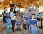 На Прикарпатті п'ять років працює організація, яка опікується дітьми з особливими потребами. бо світла надія, богородчани, опіка, особливими потребами, інвалідність, clothing, person, indoor, ceiling, footwear, man, smile, human face, boy, jeans. A group of people standing in a room