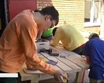 Корисні навички і соціалізація: у Дніпрі для чоловіків з інвалідністю відкрили майстерню (ВІДЕО). дцп, дніпро, майстерня, соціалізація, інвалідність, person, man, indoor, preparing, working. A man preparing food in a kitchen