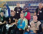 Мужні люди з «Інтеграції». го інтеграція, чернігів, змагання, спортсмен, інвалідність, person, clothing, smile, man, human face, group, people, posing. A group of people posing for the camera