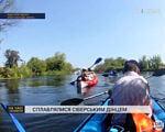 """Сумський спортивний клуб інвалідів """"Фенікс"""" сплавлявся на байдарках Сіверським Дінцем (ВІДЕО). сіверський донець, байдарка, річка, сплав, інвалідність, sky, outdoor, lake, water, sport, person, rowing, boat, watercraft. A man rowing a boat in the water"""