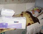 Чому держава мало дбає про людей-інвалідів? (ФОТО, ВІДЕО). теребовлянщина, волонтер, допомога, фонд чесна україна, інвалідність, indoor, newspaper, plastic bag, messy, box, cluttered, clothes. A messy bed