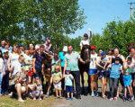 Традиційно для дітей з інвалідністю проводяться заняття з іпотерапії. полтава, заняття, лікування, інвалідність, іпотерапія, tree, person, outdoor, clothing, footwear, group, man, posing, smile, young. A group of people standing in front of a crowd posing for the camera