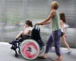 КАС ВС пропонує відступити від висновку ВСУ щодо порядку дострокового призначення пенсії за віком матерям інвалідів з дитинства. дитина, колегія суддів, мати, пенсія, інвалідність, person, road, window, riding, clothing, wheel, tire, toddler, auto part. A person riding a bike next to a window