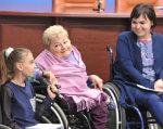 Урядовою уповноваженою з прав осіб з інвалідністю було представлено початок проекту «Дитляндія». прес-конференція, проект дитляндія, толерантність, інвалідність, інклюзивна свідомість, person, clothing, human face, wheelchair, baby, smile, toddler, seat, chair, woman. A group of people sitting in a chair
