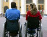 У Рівному обговорили захист прав людей з інвалідністю. рівне, круглий стіл, підтримка, суспільство, інвалідність, person, outdoor, chair, clothing, furniture, woman, wheelchair, table, seat, cart. A person standing next to a bicycle