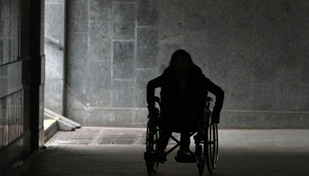 Пенсію з інвалідності отримують близько 1,4 мільйона українців. павло розенко, державна соціальна допомога, засідання, пенсія, інвалідність, building, outdoor, street, person, clothing, man. A person riding a horse on a city street