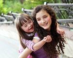 Що особливого у фінській інклюзивній освіті. фінляндія, доступність, інклюзивна освіта, інклюзія, інтеграція, outdoor, person, tree, little, girl, human face, smile, clothing, young, toddler. A little girl posing for a picture