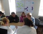 На Луганщині людей з інвалідністю навчають впливати на владу та захищати власні права. луганщина, громадська участь, семінар, тренинг, інвалідність, person, indoor, human face, clothing, woman, whiteboard, group, man, people, classroom. A group of people sitting at a desk