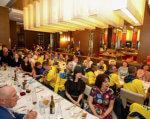 Україна здобула на Invictus Games у Сіднеї на 6 медалей більше, ніж торік. invictus games, ігри нескорених, ветеран, змагання, медаль, person, table, indoor, sitting, group, wall, people, clothing, ceiling, event. A group of people sitting at a table in a restaurant