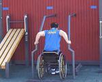 У Києві збудували інклюзивний сrossfit-майданчик (ВІДЕО). київ, кросфіт, сrossfit-майданчик wodtest, спортсмен, інвалідність, ground, outdoor, wheelchair, sports equipment, disabled sports, individual sports, wheelchair sports. A person sitting on a bench
