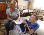 "Новий проект Суспільного мовника про інклюзивність ""Разом"". проект разом, стереотип, суспільство, інвалідність, інклюзивність, person, sitting, clothing, indoor, boy, food, table, furniture, woman. A young boy sitting at a table"