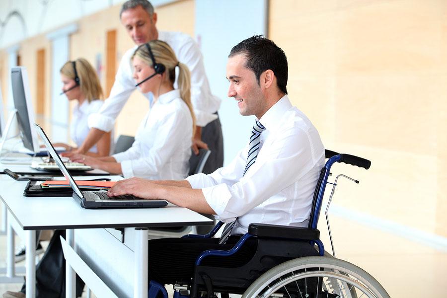 Надання послуг особам з інвалідністю. безробітний, вакансія, профорієнтація, центр зайнятості, інвалідність, person, computer, indoor, man, laptop, clothing. A person sitting at a desk with a laptop