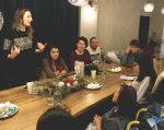 Дівчат з інвалідністю навчали техніки макіяжу. івано-франківськ, майстер-клас, макияж, навчання, інвалідність, person, clothing, indoor, human face, woman, group, man, people, smile, table. A group of people sitting at a table